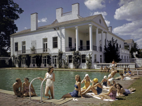 joseph-baylor-roberts-people-sunbathe-beside-a-swimming-pool-at-charlotte-country-club